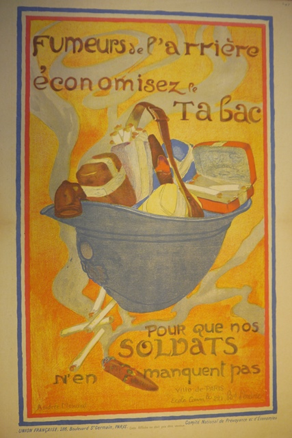 Poster of a soldier's helmet filled with tobacco products