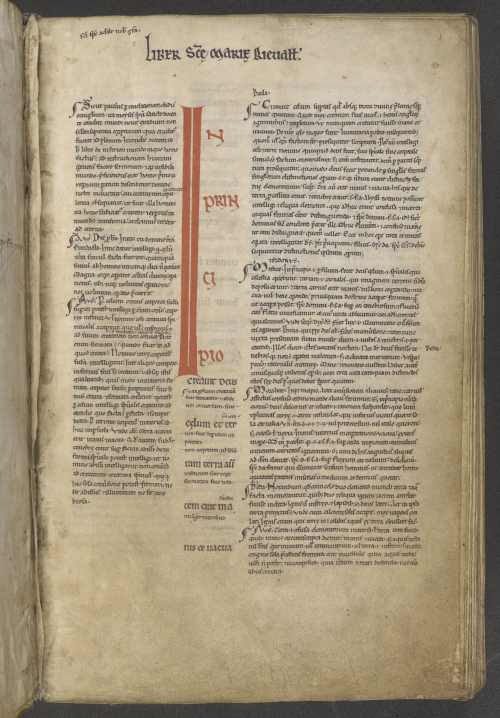 A manuscript of the Book of Genesis, showing the text with interlinear and marginal glosses.