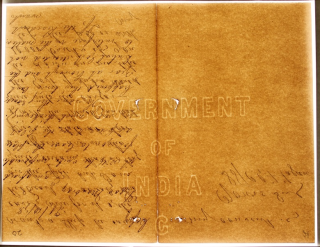 a comparison to the left hand image of  laid and wove paper, this image of a machine-wove page from the India Office Records, shows the difference in paper, with no chain and wire lines and a clearer paper. The Page itself has again, a large watermark underneath the text, of the words 'Government of India'. Superimposed is flowing cursive handwriting in black ink.