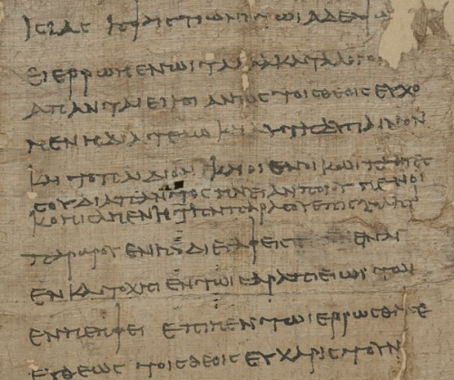 A detail from a papyrus, showing the text of a letter in Ancient Greek, written by a wife for her husband.