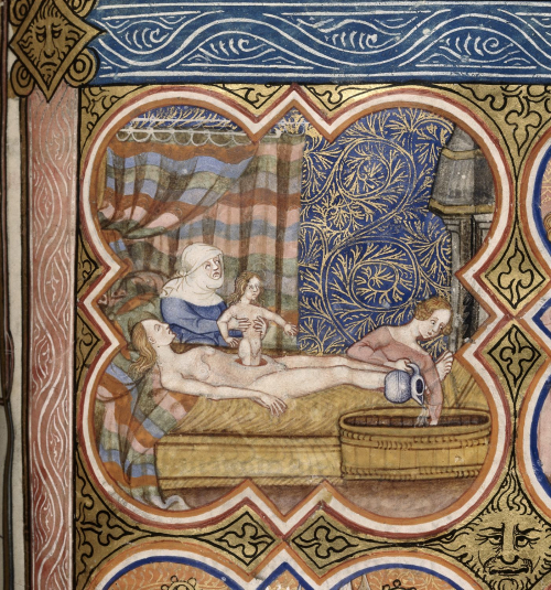 A detail from a medieval manuscript, showing an illustration of the birth of Julius Caesar, with a midwife in attendance.