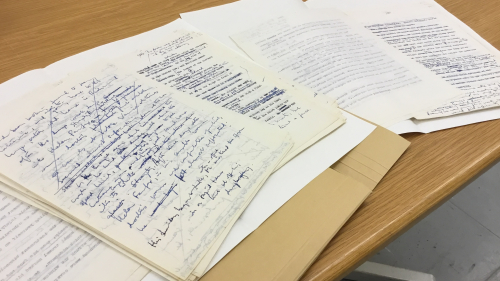 Manuscript material from the Ballard archive, arranged across a table