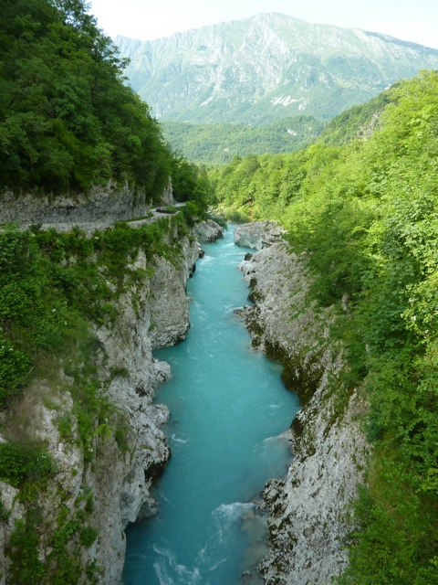 A gorge with a river, and a narrow road cut into one side