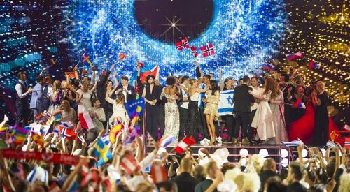 Performers and audiences waving flags at the 2015 Eurovision Song Contest