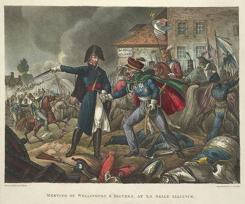 Wellington and Blücher shaking hands as they meet on the battlefield