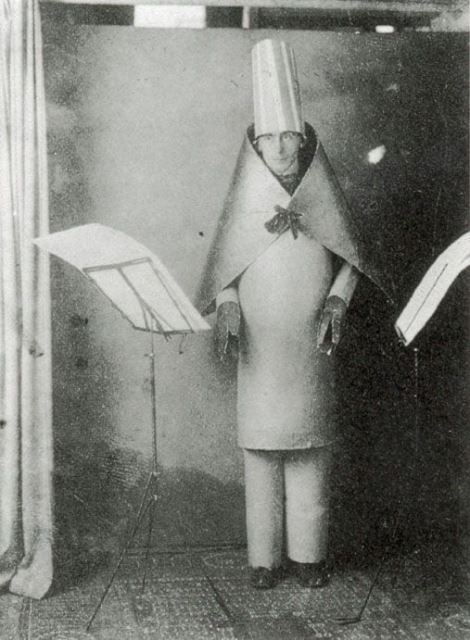 Hugo Ball in a costume of cardboard tubes, with a stiff cardboard cape and tall hat