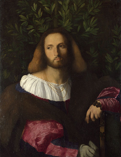 Painting of a bearded man against a background of laurel leaves