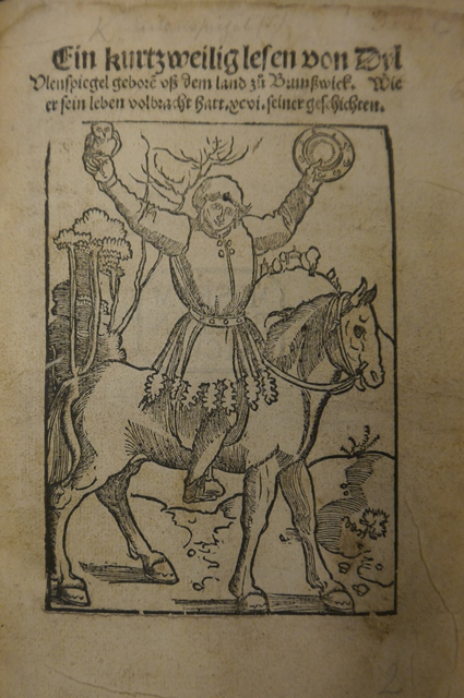 Woodcut illustration of Till Eulenspiegel on horseback holding an owl and a mirror