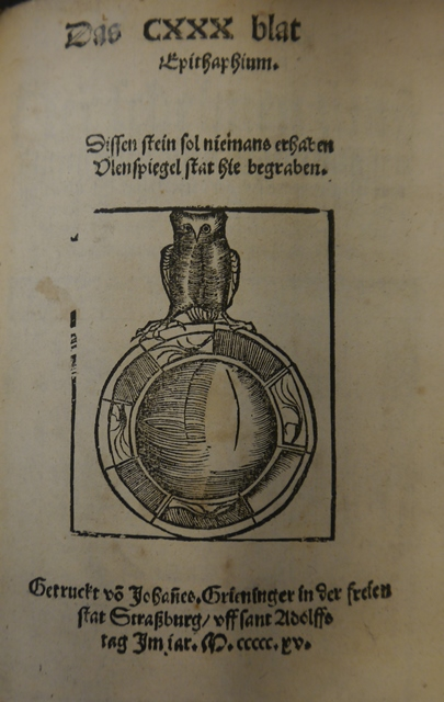Colophon of 'Ein kurtzweilig leren von Dyl Ulenspiegel' with woodcut of an owl perched on a mirror