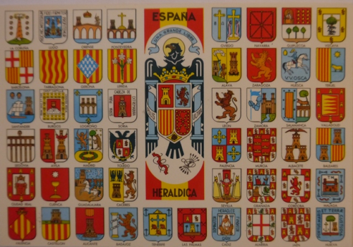 1970s Spanish postcard showing the arms of different cities surrounding the national arms with yoke and arrows