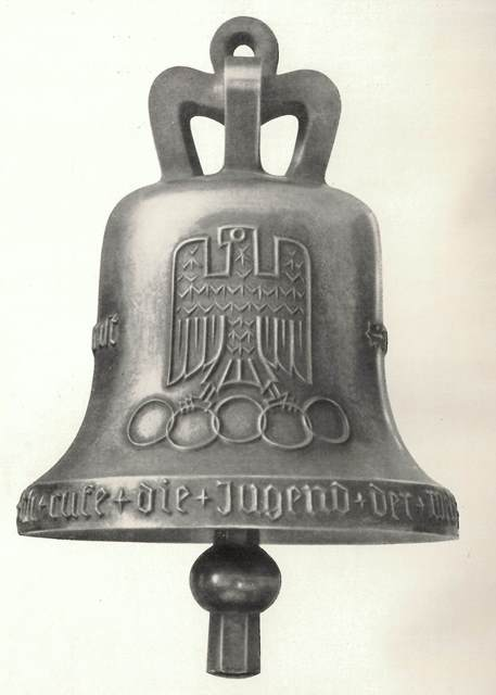 The 1936 Olympic Bell with an image of an eagle holding the Olympic rings in its talons, and the motto, 'Ich rufe die Jugend der Welt'