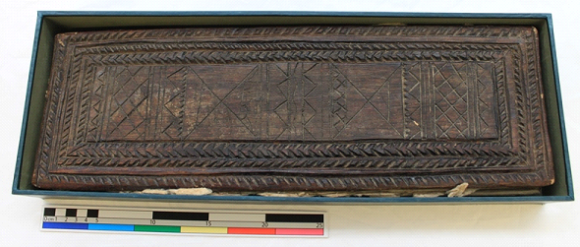 A bird's eye view of the book showing the wooden boards with geometric carvings.