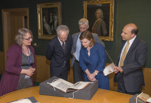 Tuija Ainonen, Roly Keating, Kristian Jensen, and Rachel and Marc Polonsky viewing a manuscript of the Gospel of Mark.