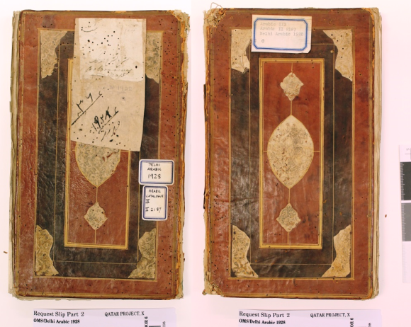 The front and back cover of the manuscript, lying side by side, completely separated from the text block and spine. The covers are handmade and roughly the same in imagery, bearing a central ovoid which has had its illustration worn away. This shape is buttressed at either end by two shield-like shapes, which again bear traces of imagery. They are on a brown background, framed in black, in itself framed in brown. Both covers bear writing on white stickers.