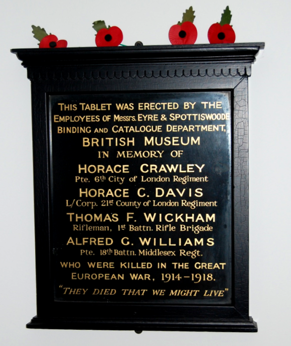 The plaque honouring the four bindery staff members killed in World War 1. The plaque is black with gold text.