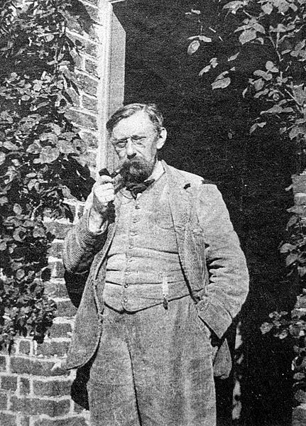Photograph of Verhaeren in 1910, smoking a pipe outside his house