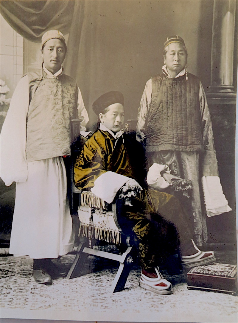 Photograph of the Chogyal with two advisers.