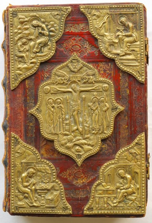 Cover with embossed brass lozenges showing depictions from The Gospel.
