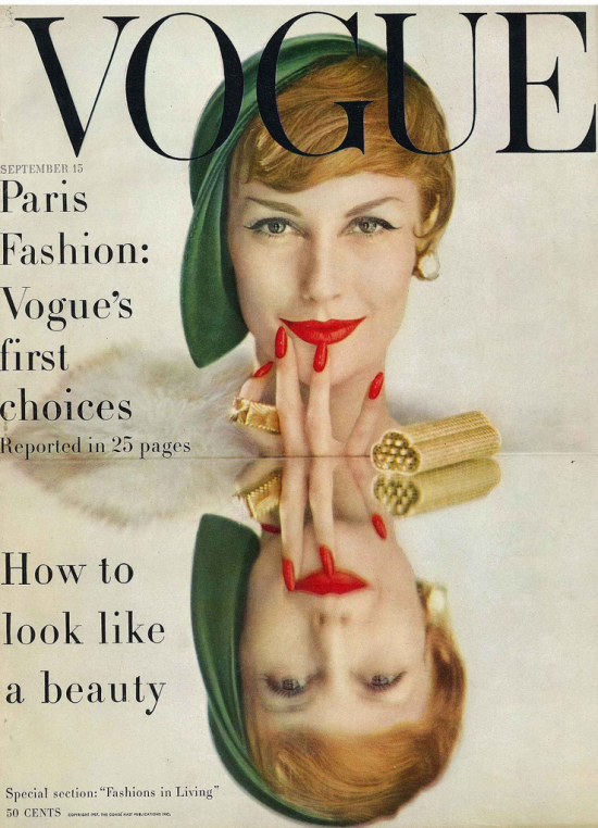 Vogue cover featuring a glamorous woman with bright red lipstick and fingernails