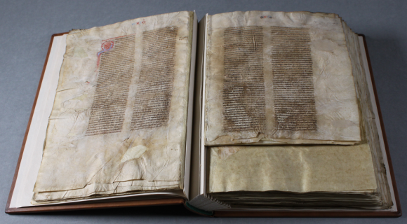 After treatment, the manuscript in this image is shown to lie much more flatter, and the pages much more easily opened. The new guard structure can be seen running up the spine and gutters of the parchment pages, helping the parchment lie flat.