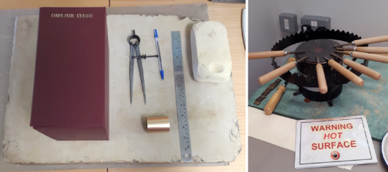 Two images showing the gold tooling shelfmark on the outside of the new Buckram box. The first image displays the tooling on the spine of the box, alongside some tools, including  callipers and a steel ruler. The next image shows a type of hot-plate, with a ring outside a central element, where wooden hilted tools are resting, their metal tips sitting on the element to heat up. A Warning, Hot Surface sign is also displayed.