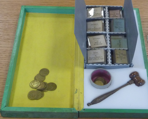 Case, tokens and gavel for the Round Game of Trade and Barter  Playing Pieces
