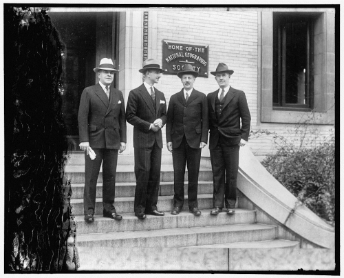 Photo of the four person team standing on steps