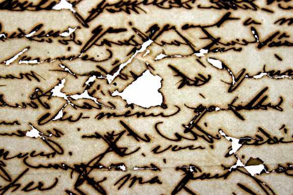 Handwritten text with iron gall ink showing some areas of severe loss where the iron gall ink has destroyed the paper.