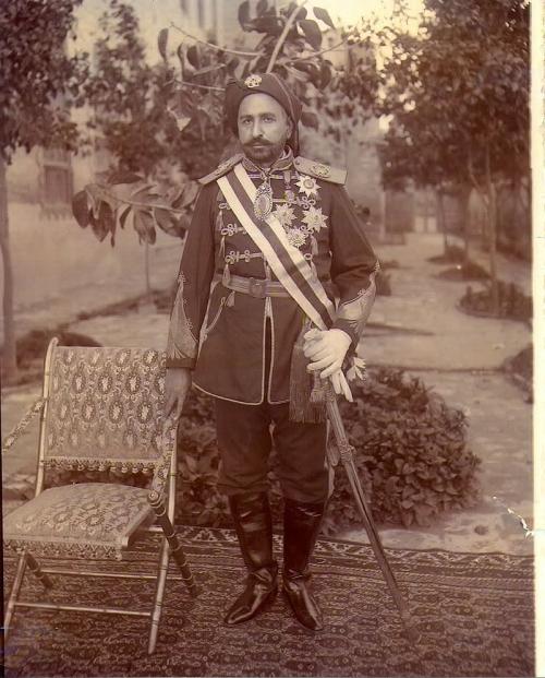 Photograph of Shaikh Khaz'al bin Jābir bin Mirdāw al-Ka'bī wearing military uniform and honours