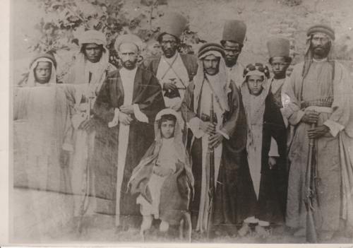 Photograph of men in traditional Arabic dress