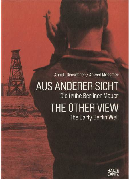 "Cover of ""Die Mauer aus anderer Sicht"" showing an East German Border Guard looking towards a watch tower"