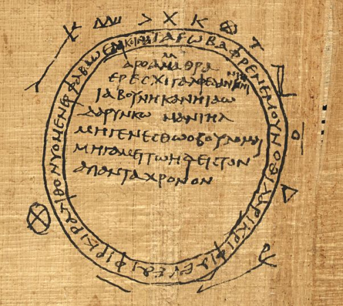 A detail from a 4th-century papyrus, showing an illustration of a magic ring and the text of a spell.
