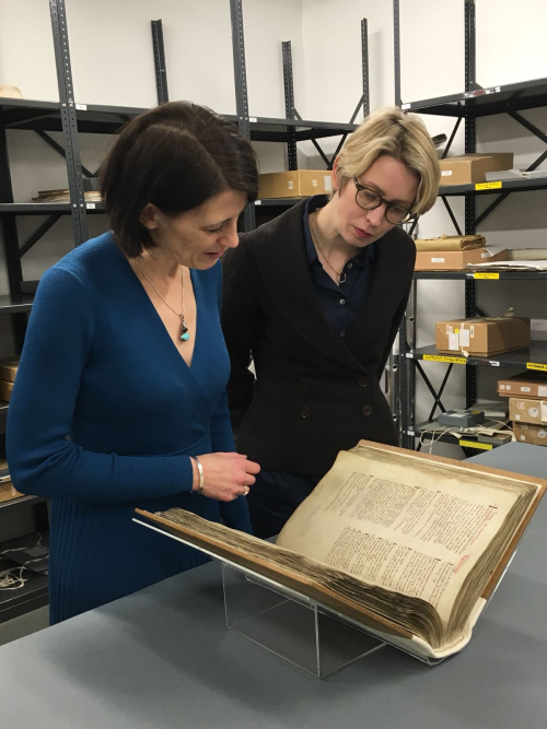 Dr Claire Breay and Dr Jessica Nelson consult the Domesday Book.