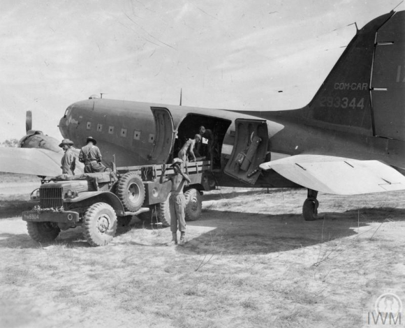 Royal Indian Army Service Corps troops unload an American C-47 cargo plane at an airstrip in the Pinwe area