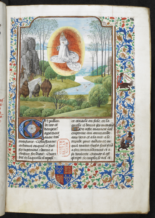 A page from a highly illuminated Bible, showing an illustration of God creating the animals of the world.