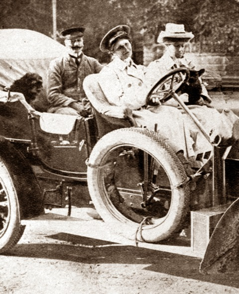 Photograph of Lucy Christalnigg at the wheel of a car with two passengers and a dog