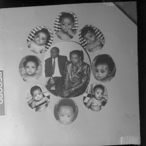 Cut out photograph of a couple with oval cut outs of babies around the central image.