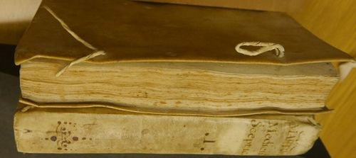 2 volumes in soft parchment bindings with the remains of original fastenings