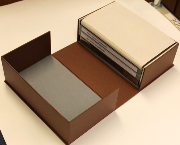 All parts of the repaired book sit in a bespoke box covered with brown buckram.