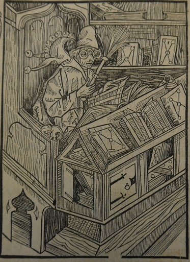 Woodcut of a man with glasses and a fool's cap surrounded by books