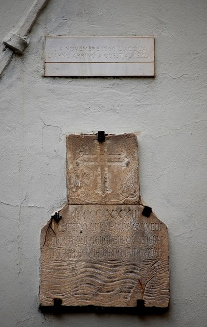 Wall plaques marking the height reached by the River Arno in the floods of 1933 and 1966