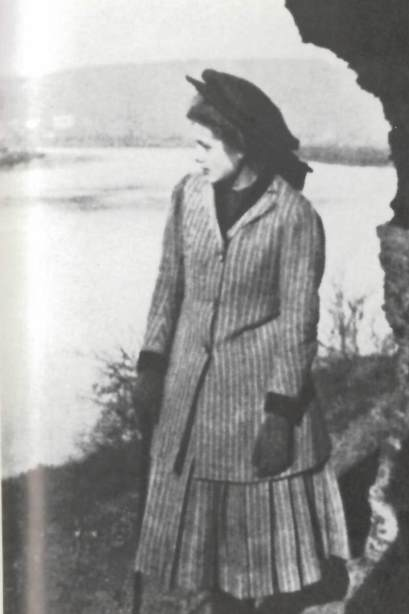 Photograph of Milena aged 13 standing by a river