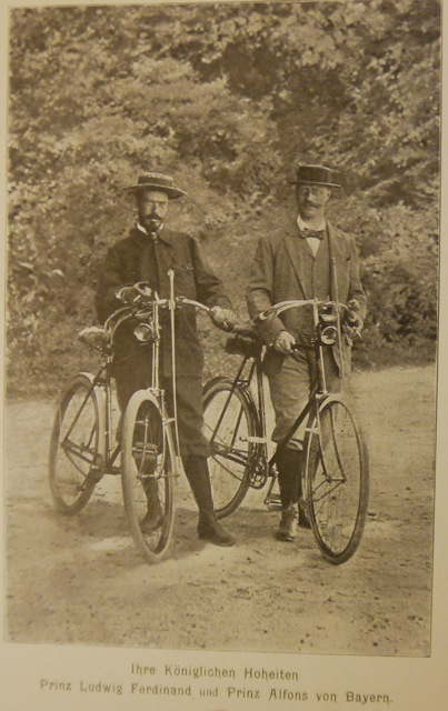 Photograph of Princes Ludwig Ferdinand and Alfons of Bavaria standing beside their bicycles