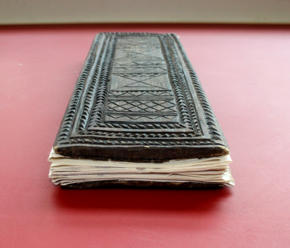 A close-up of the volume's foredge showing its repaired pages.