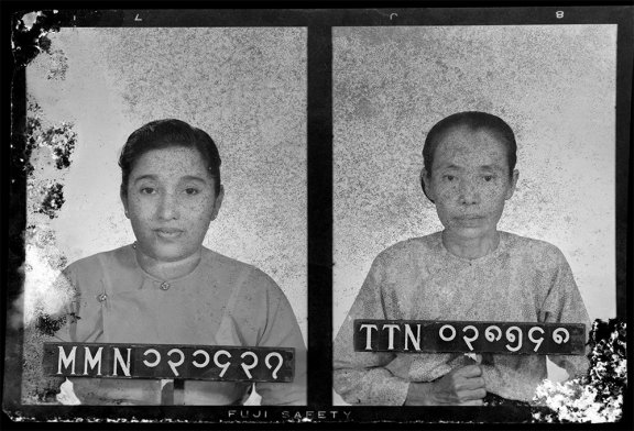 Two portraits of women each woman holds an identifier strip
