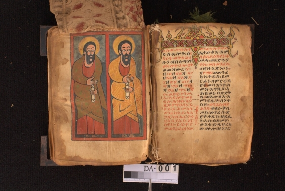 Opened Ethiopic manuscript with illustration on the left page.
