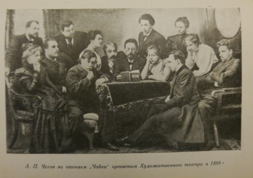 Photograph of Chekhov reading to a group of actors