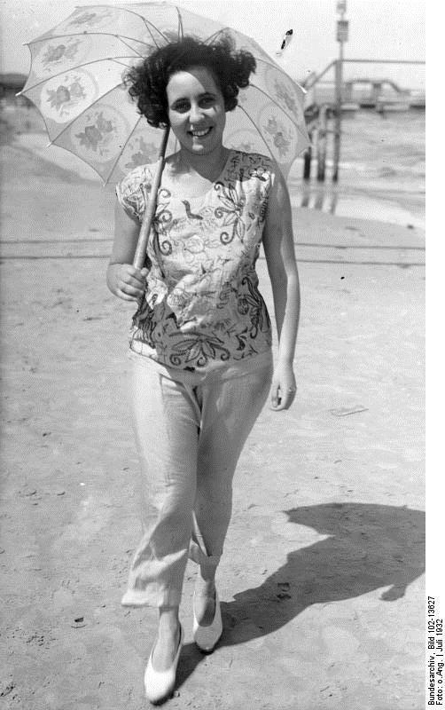Photograph of woman in beach pyjamas