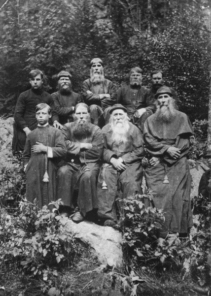 Group of men wearing religious robes.