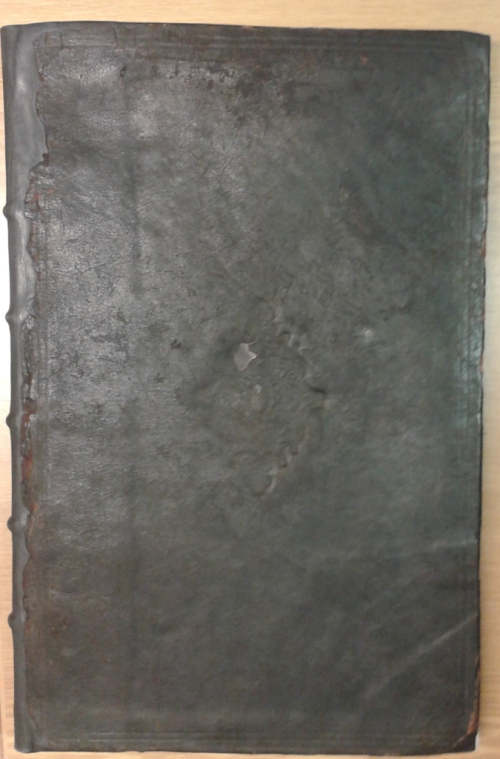 Black cover of book of misdemeanours